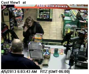 Female Suspect At Cash Register (2)