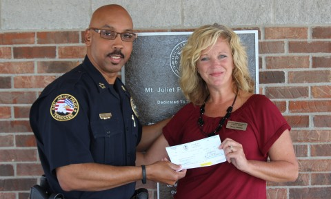 Chief James Hambrick and Dawn Cathey with MCHRA Meals on Wheels